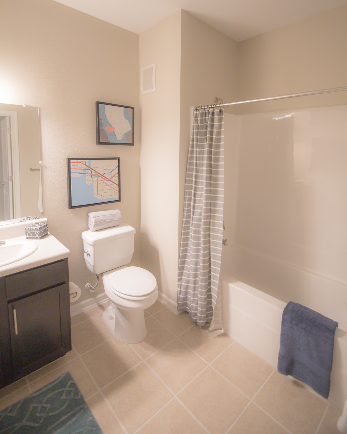 Bathroom at Goodnight commons with tub shower, tile flooring, and dark brown vanity