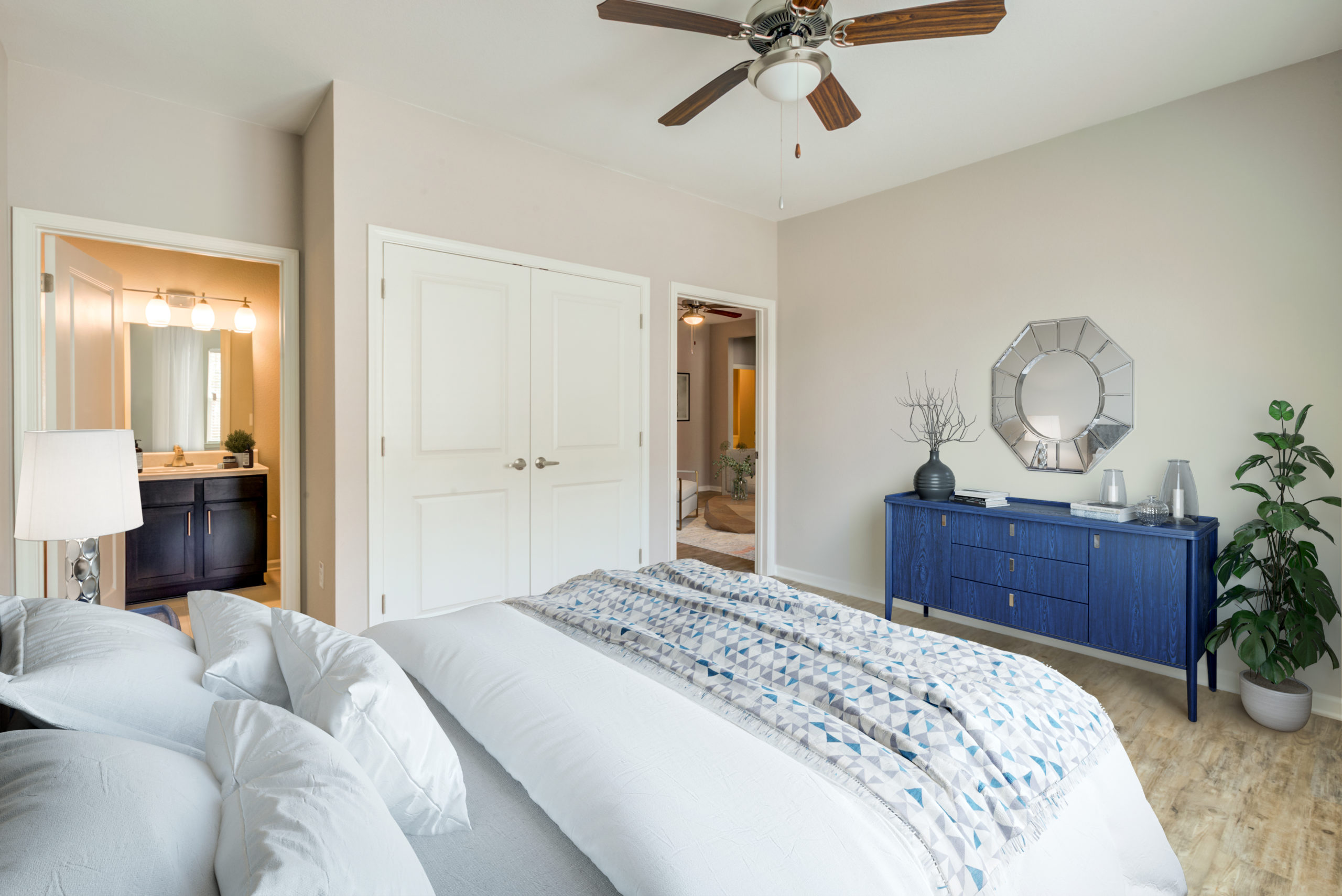 Bedroom at Goodnight Commons with carpet flooring, gray daybed, and wood desk.
